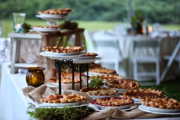 A buffet of pies displayed at various heights.