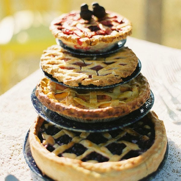 4 pies stacked to resemble a traditional wedding cake.