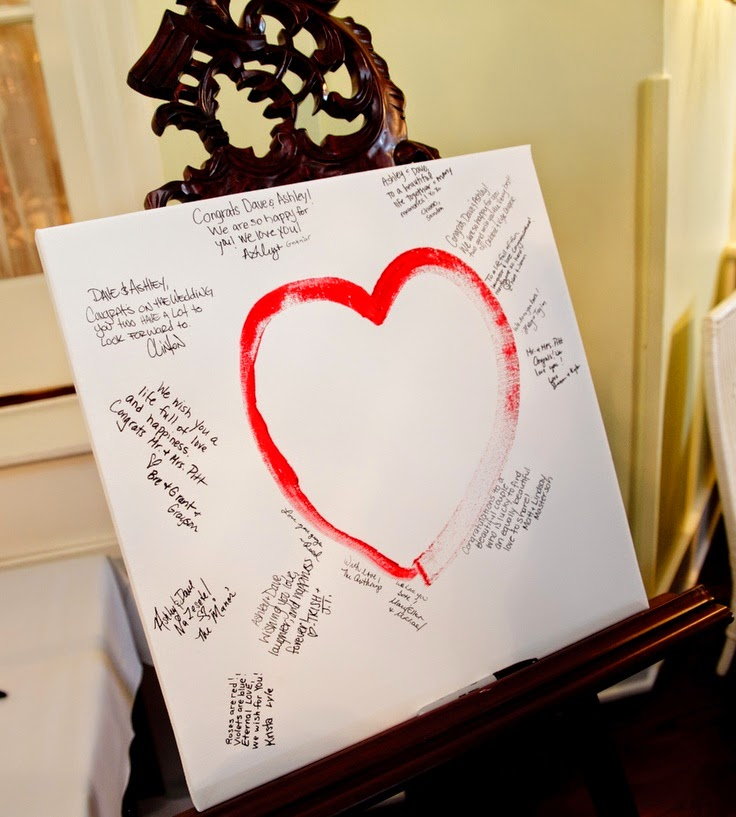 This couple painted a heart together during the ceremony. During their reception their wedding guests signed the canvas in lieu of a guest book.