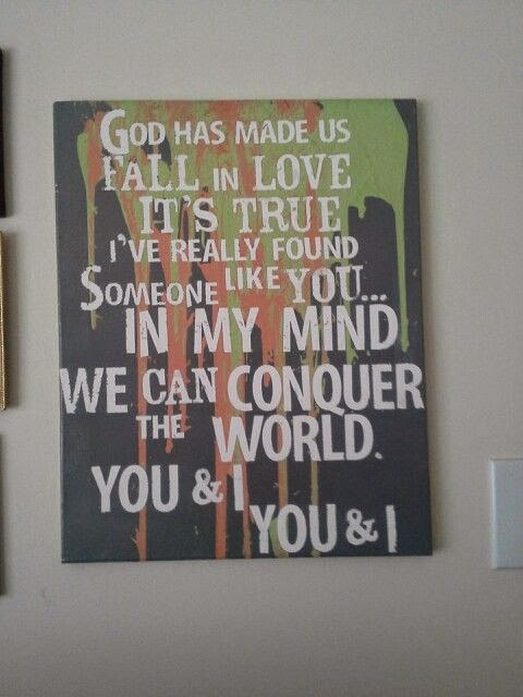 This photo features a canvas with the lyrics to a couples first dance song.